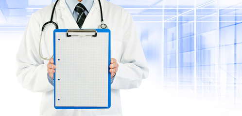 doctor holding graph paper