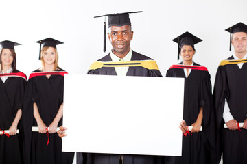 male african graduate with white board