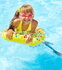 Child in swimming pool.