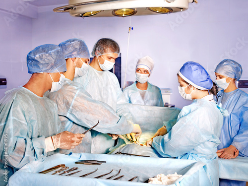 Woman on gurney in operating room.