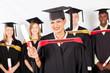 happy female indian graduate with classmates at graduation