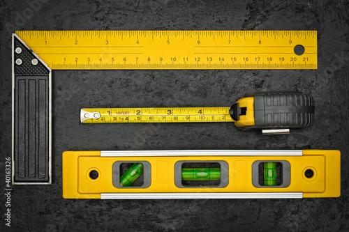 Measuring tools on a black metallic background