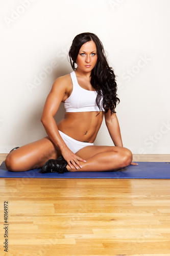 Female is during her fitness training