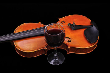 Violine and wine isolated on black