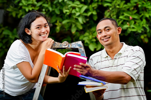 ethnic young couple study books together