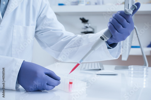 Scientist processing DNA sample in laboratory