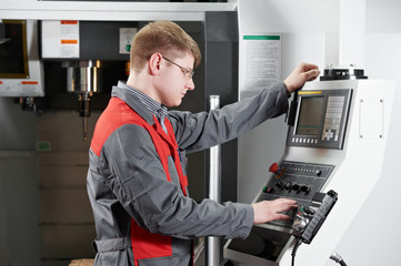 laborer working with machine tool