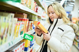 woman making bio food shopping at grocery store