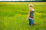 Candid carefree adorable woman in field poster