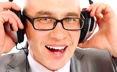 businessman wearing headphones looking to camera