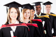 group of multiracial graduates at graduation