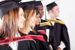 group of graduates looking away at graduation
