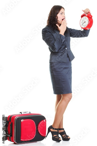 Full length young business woman to late red travel bagd