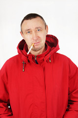 Man in a red jacket with a cigarette
