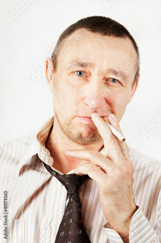 Sleazy man with a cigarette