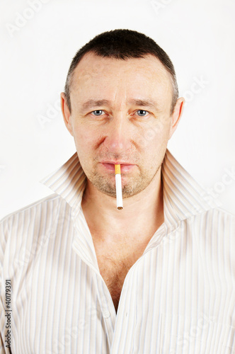 Unshaven man with a cigarette