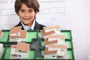Little boy pretending to be architect