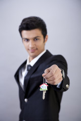Businessman Holding Keys