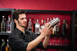 Young bartender make cocktail shaking drinks - 40184310