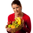 Attractive young woman with basket of varyous fruits
