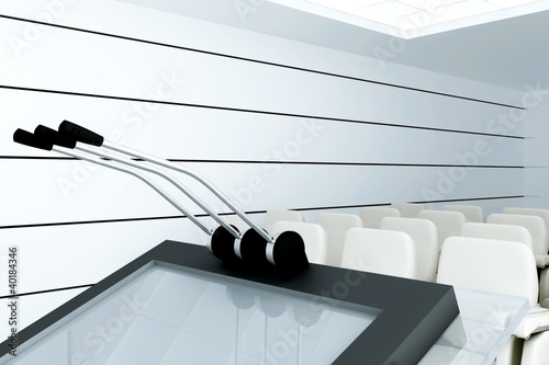 Microphones on stand  in modern conference room