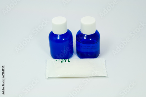 assorted personal hygiene products on plain background