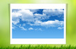 green grass and blue sky on white paper
