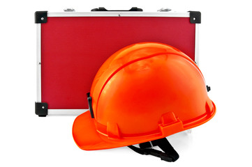 Orange helmet and red suitcase