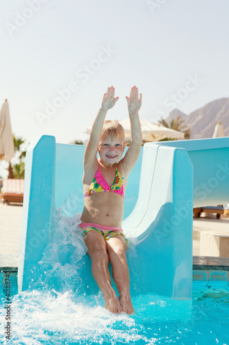 happy little girl on slide