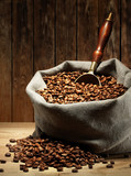 Fototapety Coffee beans on burlap sack