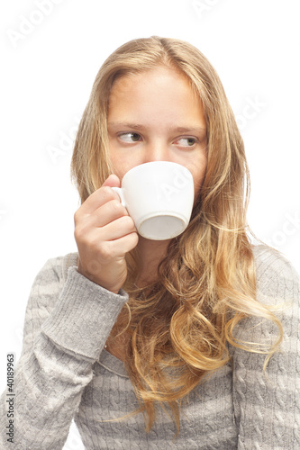 young blond girl with white cup