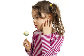portrait of  little girl with a lollipop, isolated on white