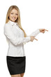 Beautiful blond business woman pointing at copy space