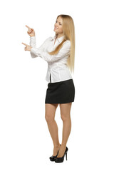 Full length of beautiful business woman pointing at copy space