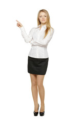 Full length of business woman pointing at copy space