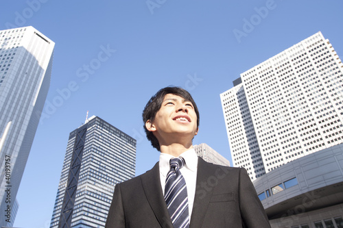 A building and a young businessman