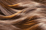 Beautiful healthy shiny hair texture with highlighted golden str