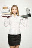 Female holding heavy stack of books and laptop
