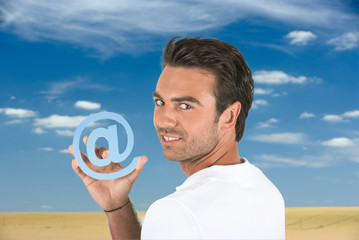 Man holding the at symbol