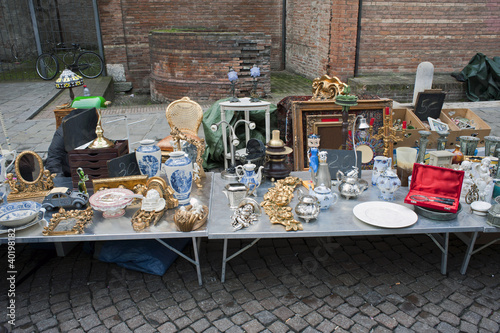 A stallholder with old artworks.