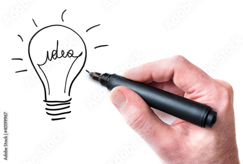Hand drawing Idea bulb on whiteboard