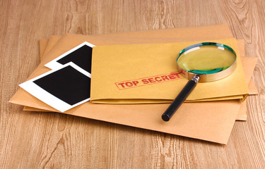 Envelopes with top secret stamp with photo papers and