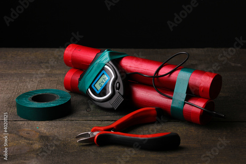 Making timebomb on wooden table on black background