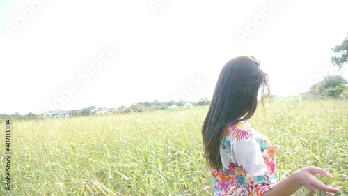 Attractive gypsie woman walking in country field