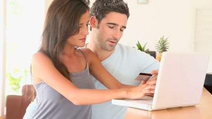 COuple at home purchasing on internet
