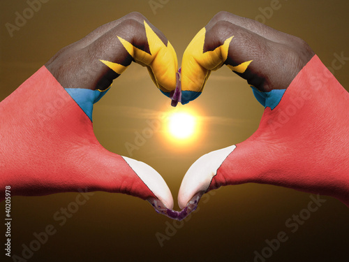 Heart and love gesture by hands colored in antigua barbuda flag