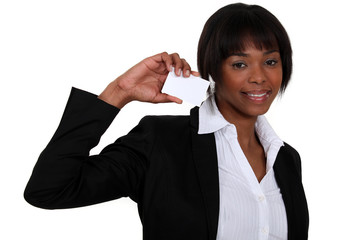 Businesswoman with a card left blank for your details
