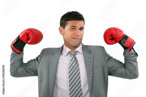 Businessman wearing boxing gloves