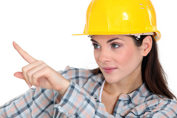 Female construction worker pointing her finger