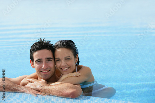 Affectionate couple in swimming pool